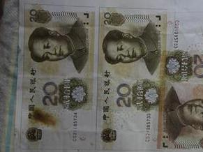 色盲男子造假币 实在太假根本花不出去 还没赚钱就被抓了